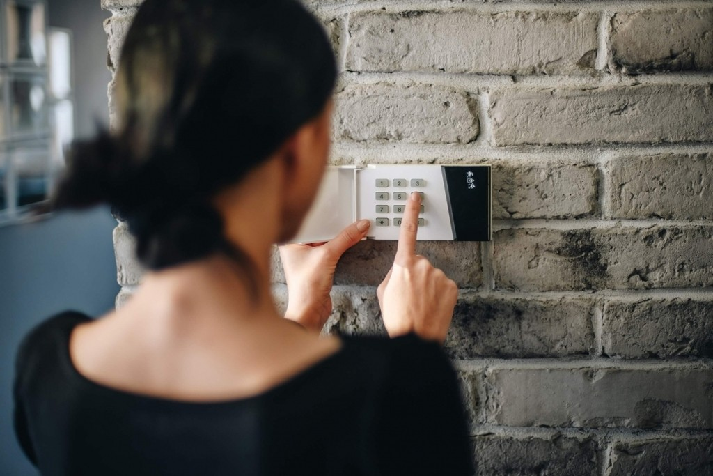 woman at security keypad